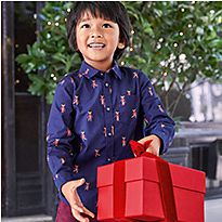 Boy wearing blue patterned M&S shirt