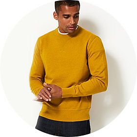 Man wearing mustard yellow knitted jumper