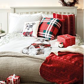 Christmas bedding and cushions on a double bed
