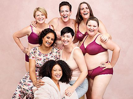 Women from the M&S Breast Cancer Now campaign wearing pink bras, knickers and sleepwear