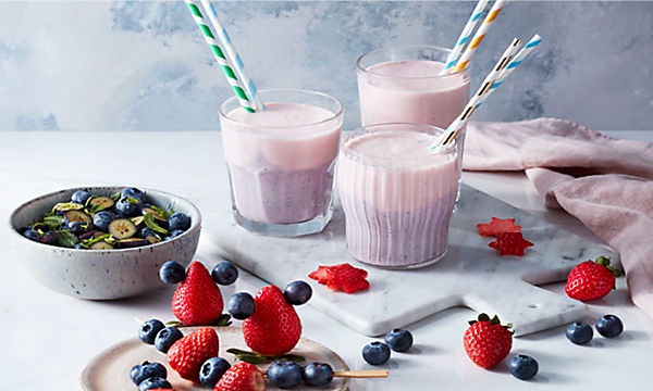 Berry smoothies and fresh berries