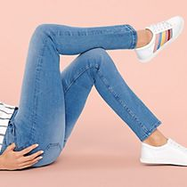 Woman wearing best-ever fit jeans and trainers