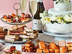 Selection of wedding party food and champagne