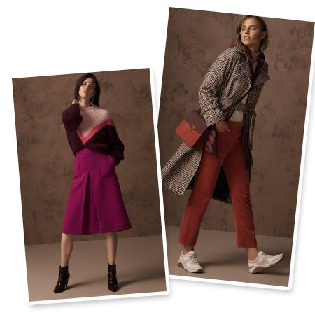 Model wears a pink and burgundy V-print sweater with a fuchsia midi skirt and black ankle boots & Model wears a grey checked coat, burnt-orange trousers, white trainers and a red cross-body bag