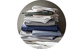 A pile of folded plain bed linen