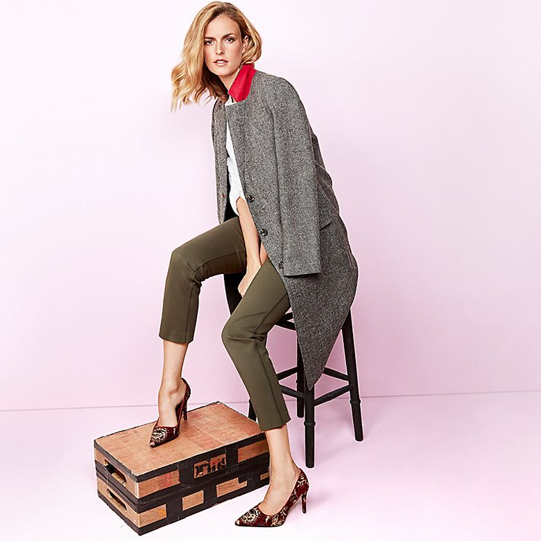 Model Jacquetta Wheeler wears tweed coat, tapered trousers and jacquard court heels