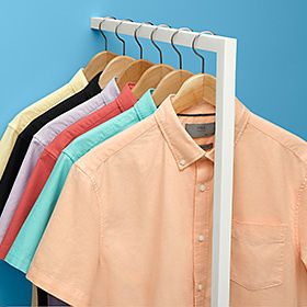 Men's casual shirts on a rail