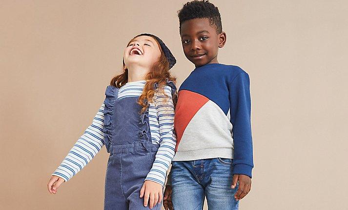 Girl and boy wearing M&S kidswear