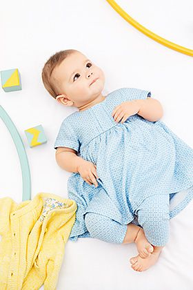 Baby girl in trousers and dress set