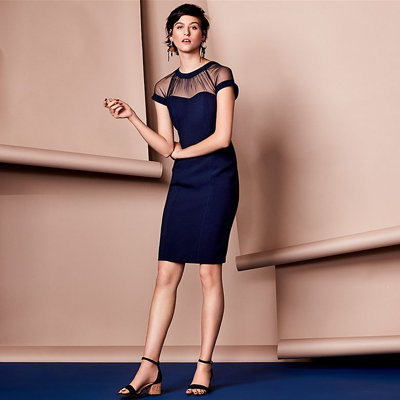 Model wears navy mesh bodycon dress