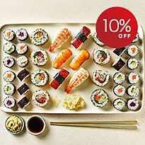 Sushi selection with chopsticks and soy sauce