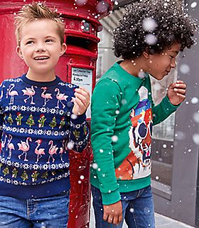Boys playing in the snow wearing M&S jumpers