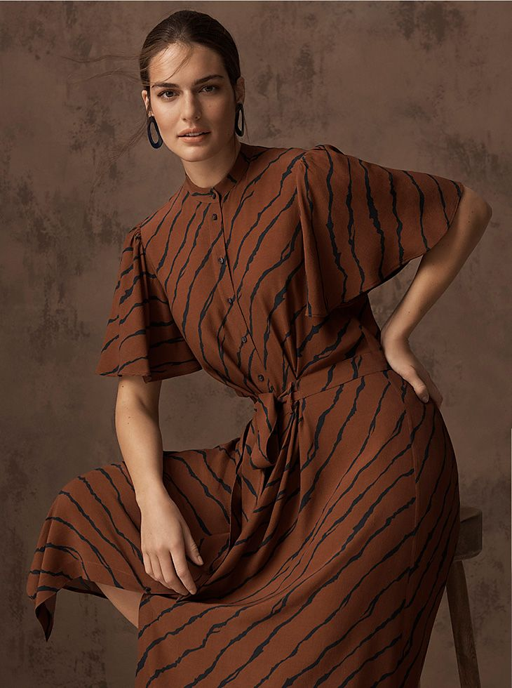 Model wears a brown tiger-print midi dress