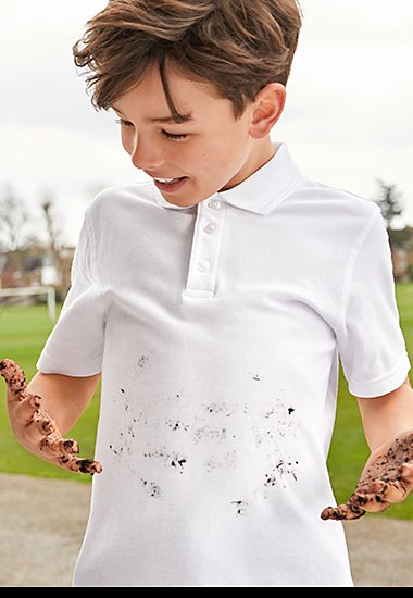 Boy wearing white M&S polo shirt