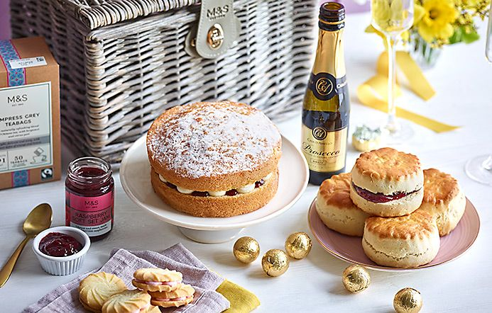 Tea-time treats hamper with cake, scones and prosecco