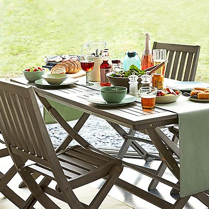 Outdoor table and chairs with food