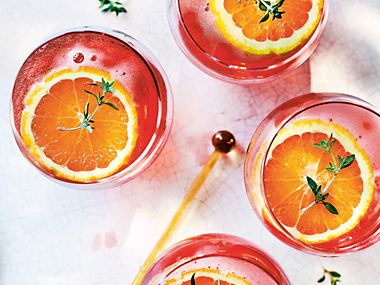 Snow white negroni in glasses with orange garnish