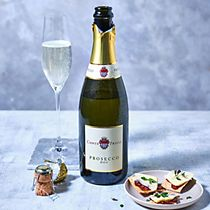 A bottle and glass of Conte Pruili prosecco