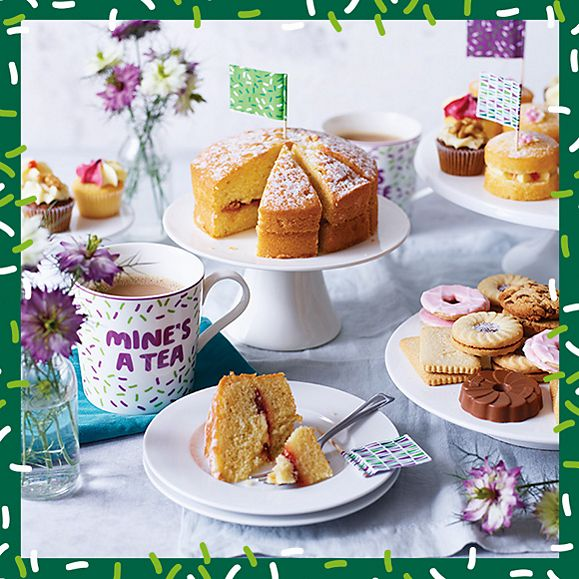 Spread of afternoon tea cakes, biscuits and tea