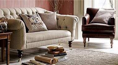 Cream sofa and leather armchair