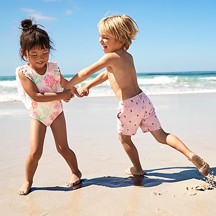 Two kids wearing M&S swimwear range