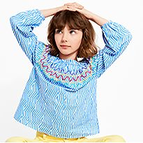 Girl wearing M&S blue patterned top