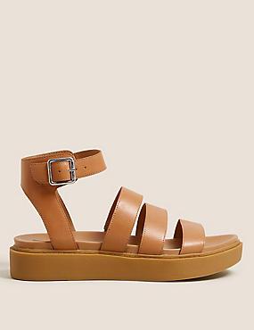 Sandales plates en cuir avec bride à la cheville