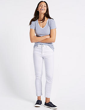 Ripped Mid Rise Relaxed Slim Jeans