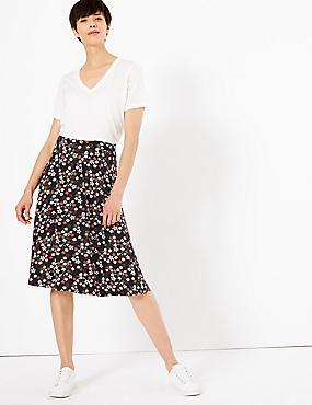 3ce2f37e7 Falda a media pierna de punto con estampado floral
