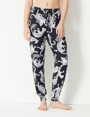 Satijnen pyjamabroek met boordjes en luipaardmotief