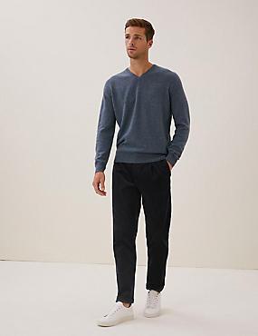 Pantalon à pinces coupe fuselée en velours côtelé