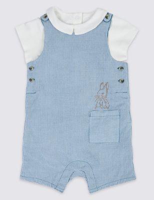 Swinging boy bunny wearing overalls