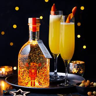 Light-up snow globe gin liqueur and festive cocktails