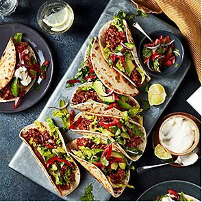 Spicy beef tacos with avocado, soured cream and salsa