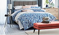 Blue-patterned bedding on a double bed