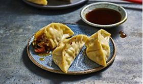 Vegetable gyozas with a soy sauce dip