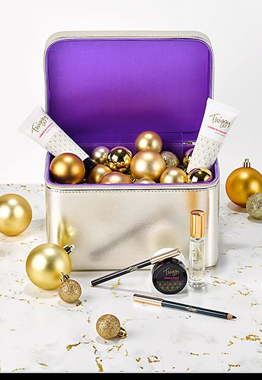 Twiggy Vanity Case make-up gift nestled among gold baubles