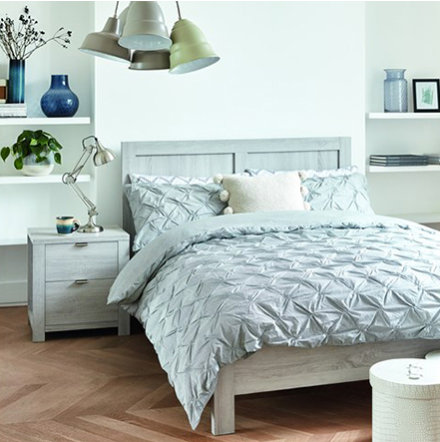 Grey bedding set in bedroom