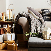 Sofa with throw, cushions and Christmas presents