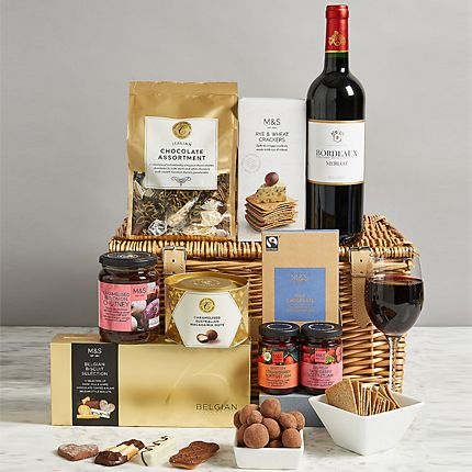 Hamper surrounded by edible treats