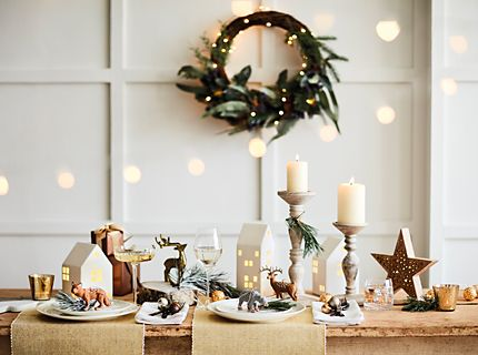 Candle holders, Christmas decorations and a wreath