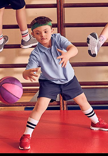 Boy wearing M&S PE kit in a school gym