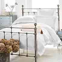 Castello metal bed with white bedding