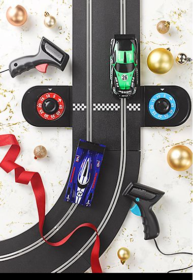 A section of a Scalextric track and cars
