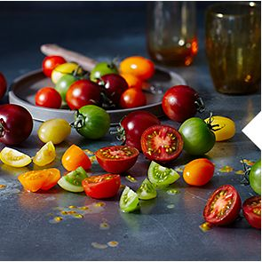 A selection of red, yellow and green M&S Select Farm tomatoes