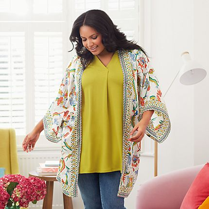 Model wearing a floral kimono, yellow top and blue jeans from the Curve collection