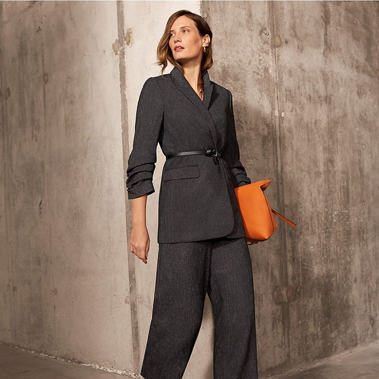 Woman wearing charcoal-grey trouser suit with heels