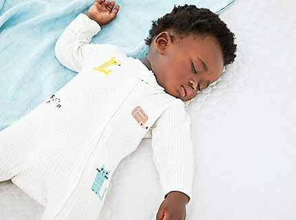 Baby wearing printed sleepsuit