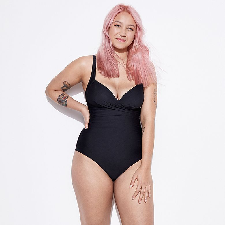 Woman wearing black longer-length swimsuit