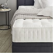 White mattress with bed linen